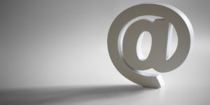 White e-mail @ symbol with shadow and copy space